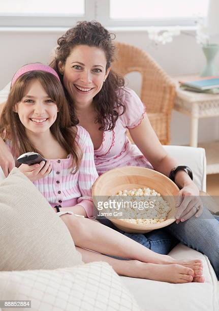 mother and daughter (10-11 years) watching tv, portrait - 10 11 years stock pictures, royalty-free photos & images