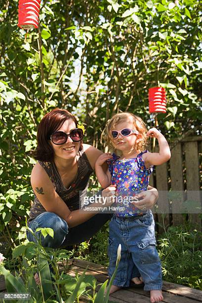 mother and daughter wearing sunglasses - jessamyn harris stock pictures, royalty-free photos & images
