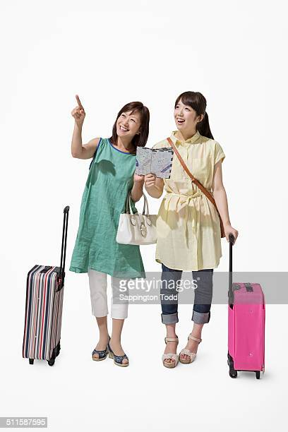 Mother And Daughter With A Suitcase And Map