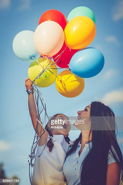 Mother and daughter with balloons