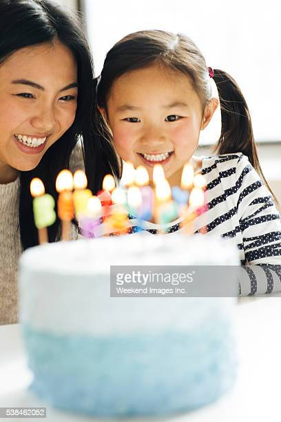 Mother and daughter with birthday cake