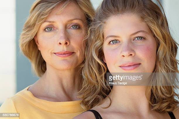 Mother and daughter with blue eyes