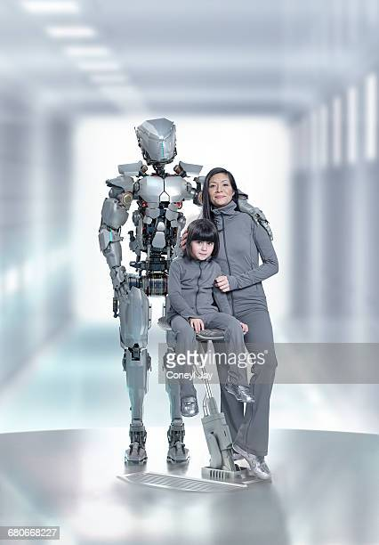 Mother and daughter with domestic robot