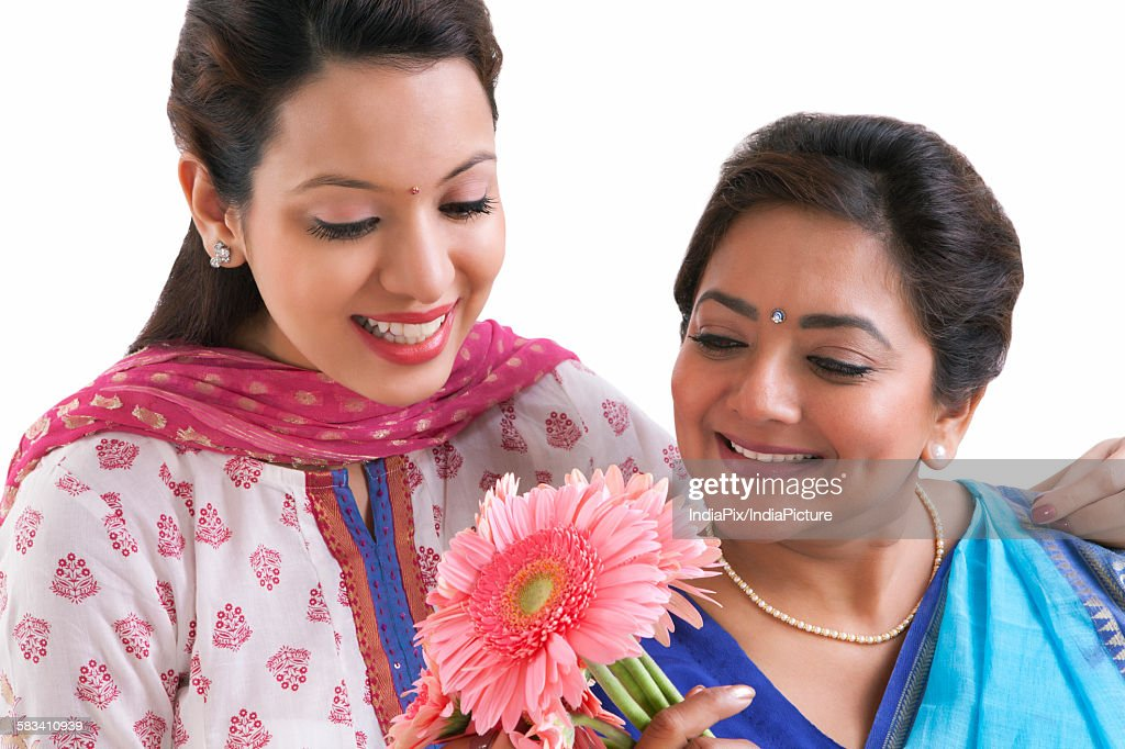 Mother and daughter with flowers : Stock Photo