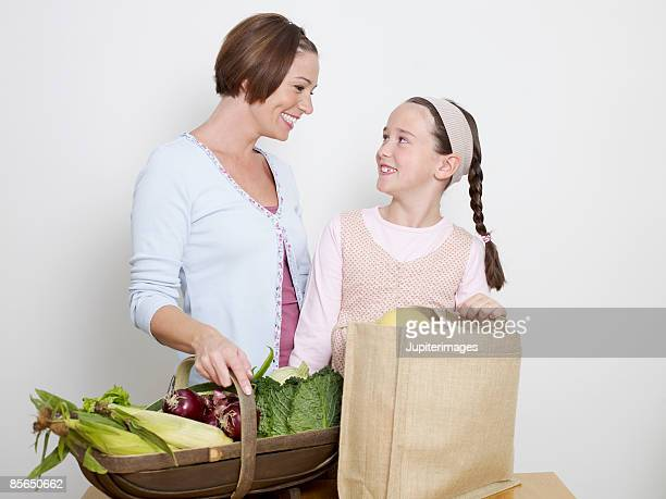 Mother and daughter with groceries