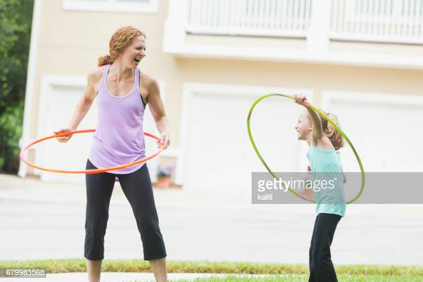 Mother and daughter with hula hoops