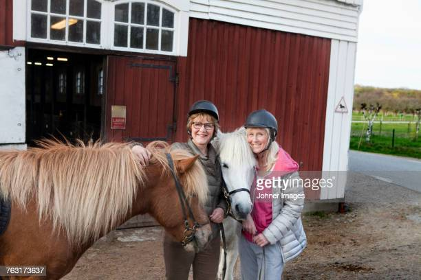 Mother and daughter with ponies