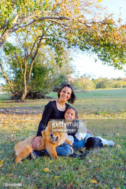 mother and daughter with puppy - chow dog stock pictures, royalty-free photos & images