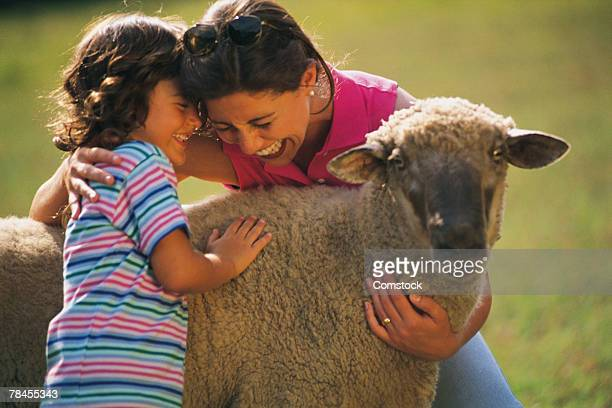 Mother and daughter with sheep