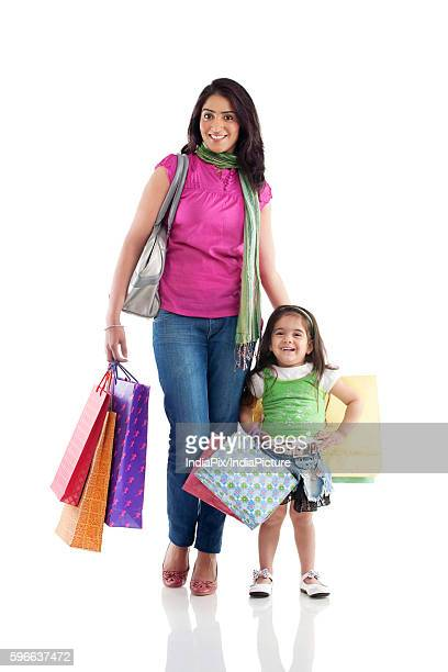 mother and daughter with shopping bags - punjabi girls images stock photos and pictures