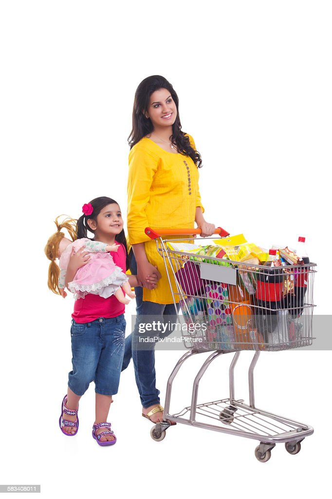 Mother and daughter with shopping cart : Stock Photo