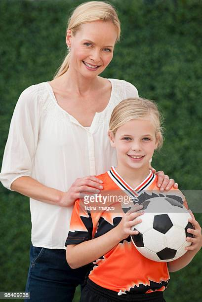 Mother and daughter with soccer ball