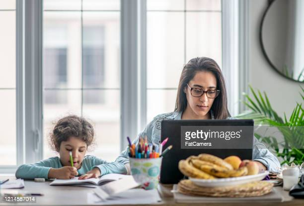 mother and daughter working from home. - social distancing stock pictures, royalty-free photos & images