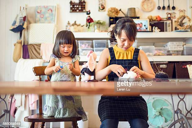 Mother and daughter working together