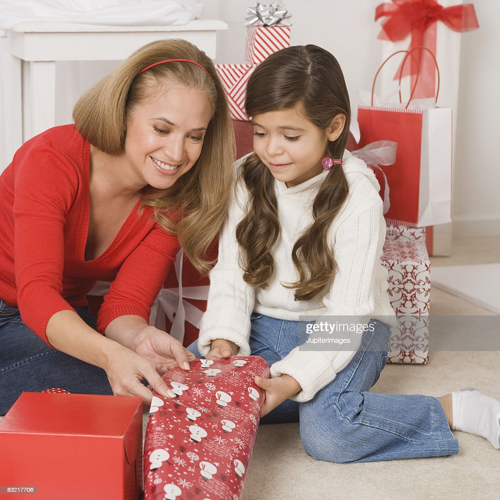 Mother And Daughter Wrapping Christmas Gifts High-Res ...