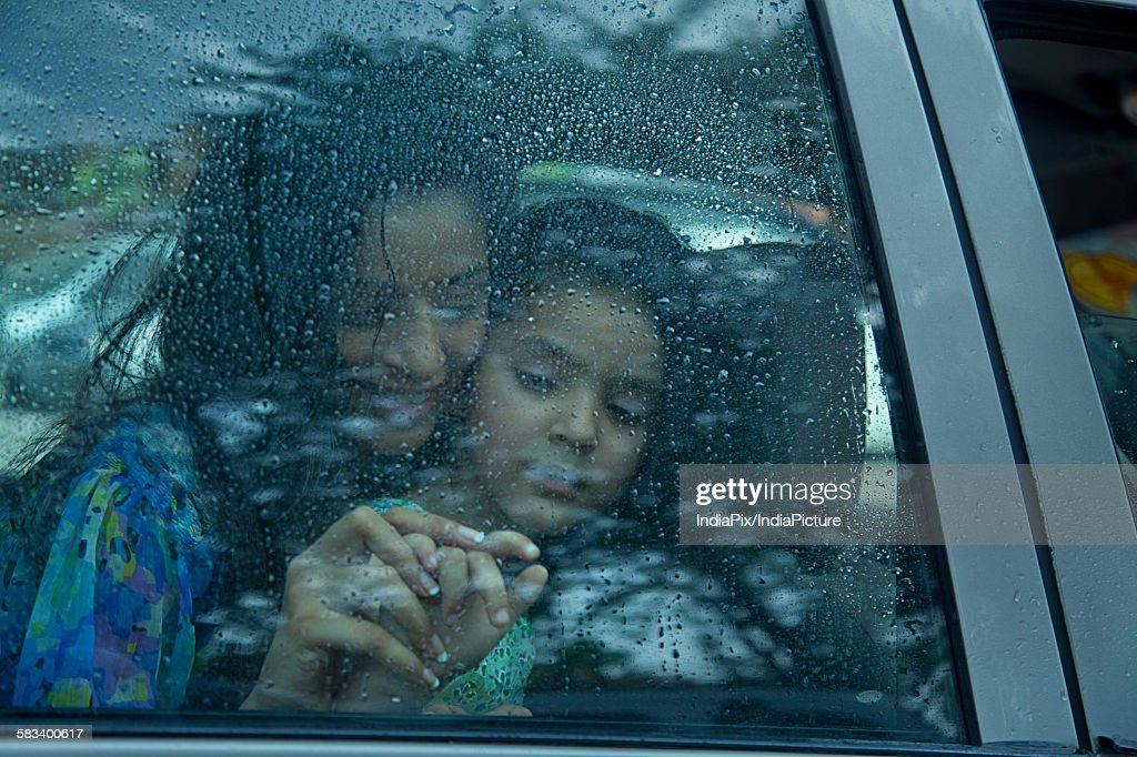 Mother and daughter writing on glass : Stock Photo