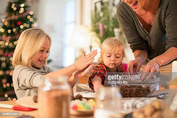 Mother and daughters baking for Christmas