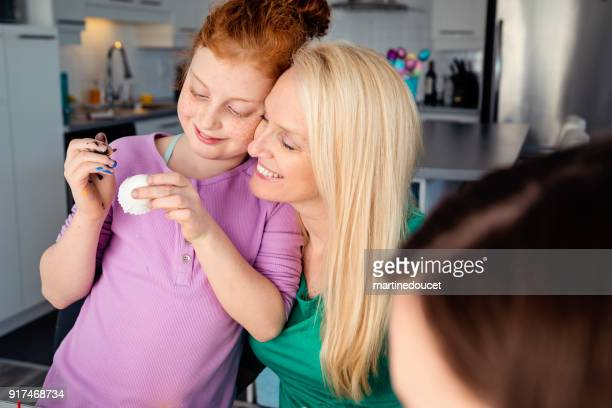 """mother and daughters crafting easter decorations at home. - """"martine doucet"""" or martinedoucet stock pictures, royalty-free photos & images"""
