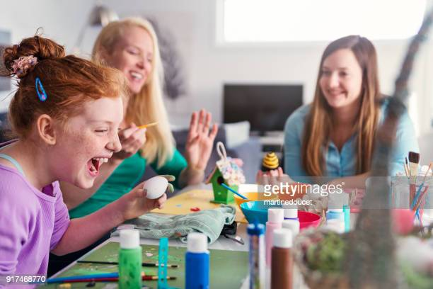 mother and daughters crafting easter decorations at home. - craft stock pictures, royalty-free photos & images