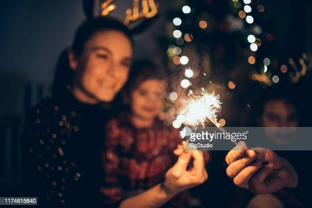 mother and daughters enjoying christmas - new year's eve stock pictures, royalty-free photos & images
