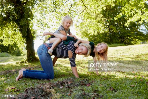 Mother and daughters enjoying park