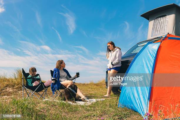 mother and daughters enjoying time away in their campervan - tent stock pictures, royalty-free photos & images