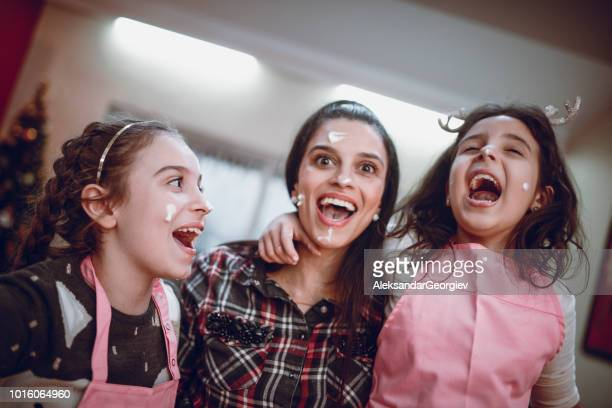 Mother And Daughters Having Fun While Baking Pastry