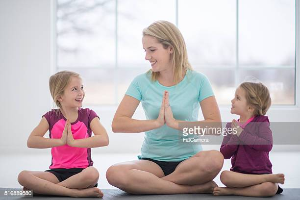 Mother and Daughters Meditating Together