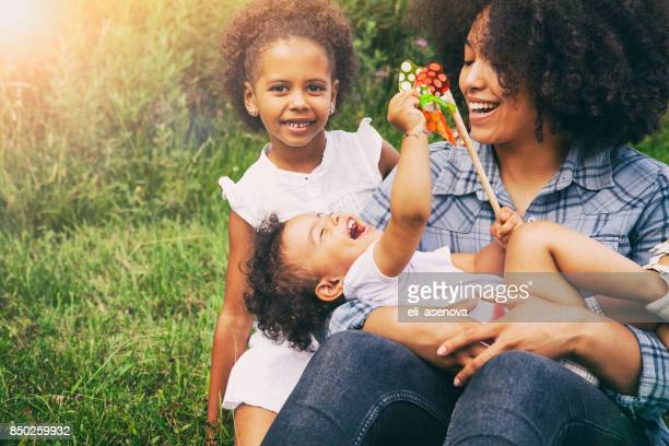 mother and daughters outside - family with two children stock photos and pictures
