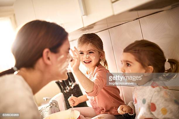 mother and daughters - naughty daughter stock photos and pictures