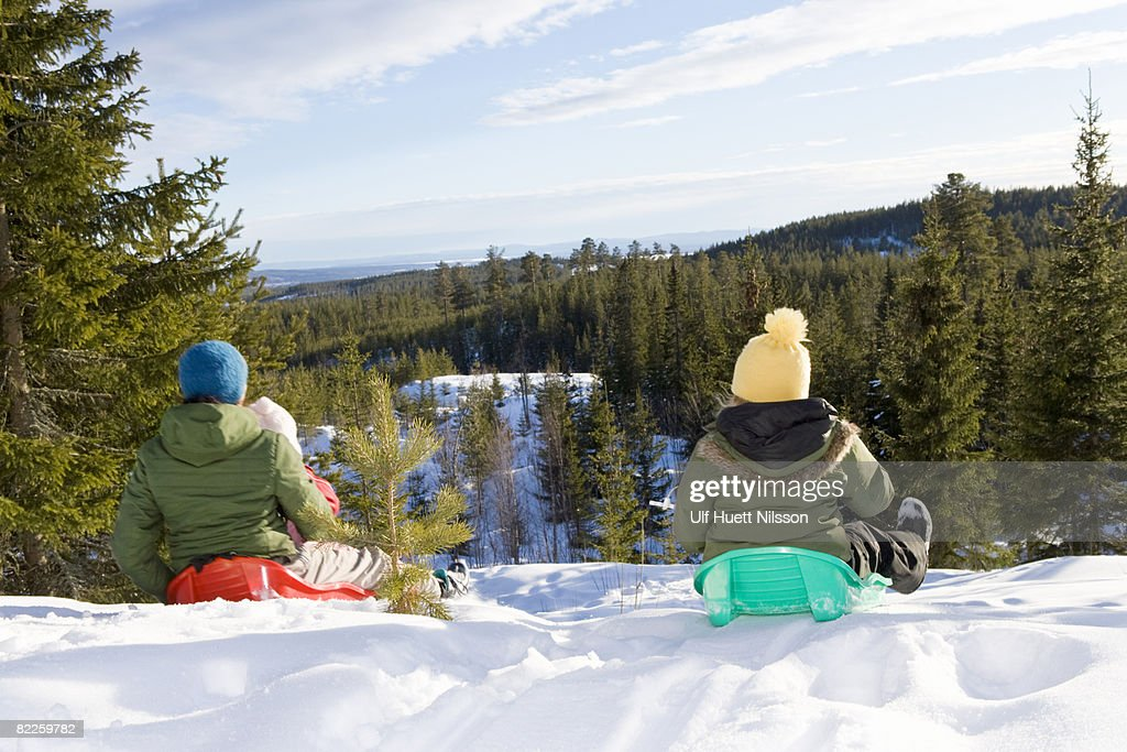 Mother and daughters playing in the snow. : Stock Photo