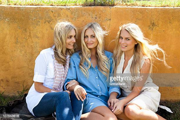 Mother and daughters sitting together