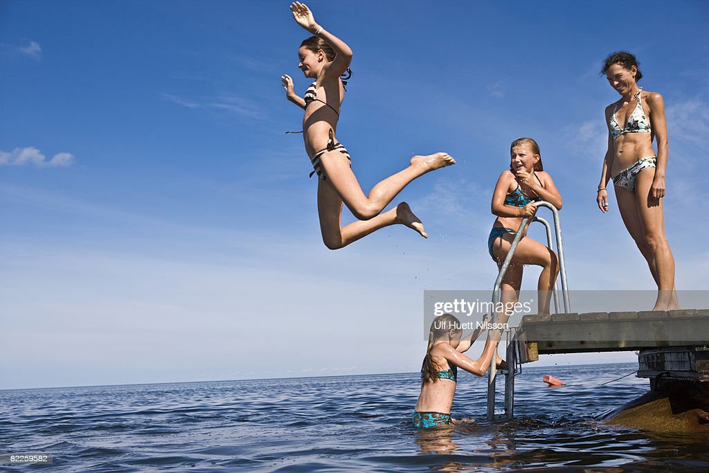 Mother and daughters swimming Oland Sweden. : Stock Photo