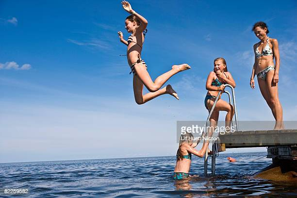 mother and daughters swimming oland sweden. - sea swimming stock pictures, royalty-free photos & images