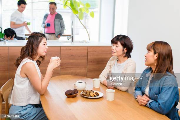 Mother and daughters talking