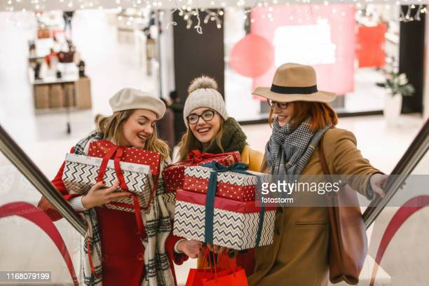 Mother and daughters with presents at the mall