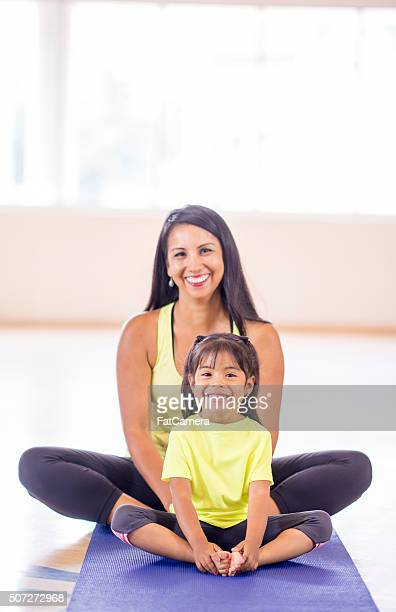Mother and Daugther Doing Yoga Together