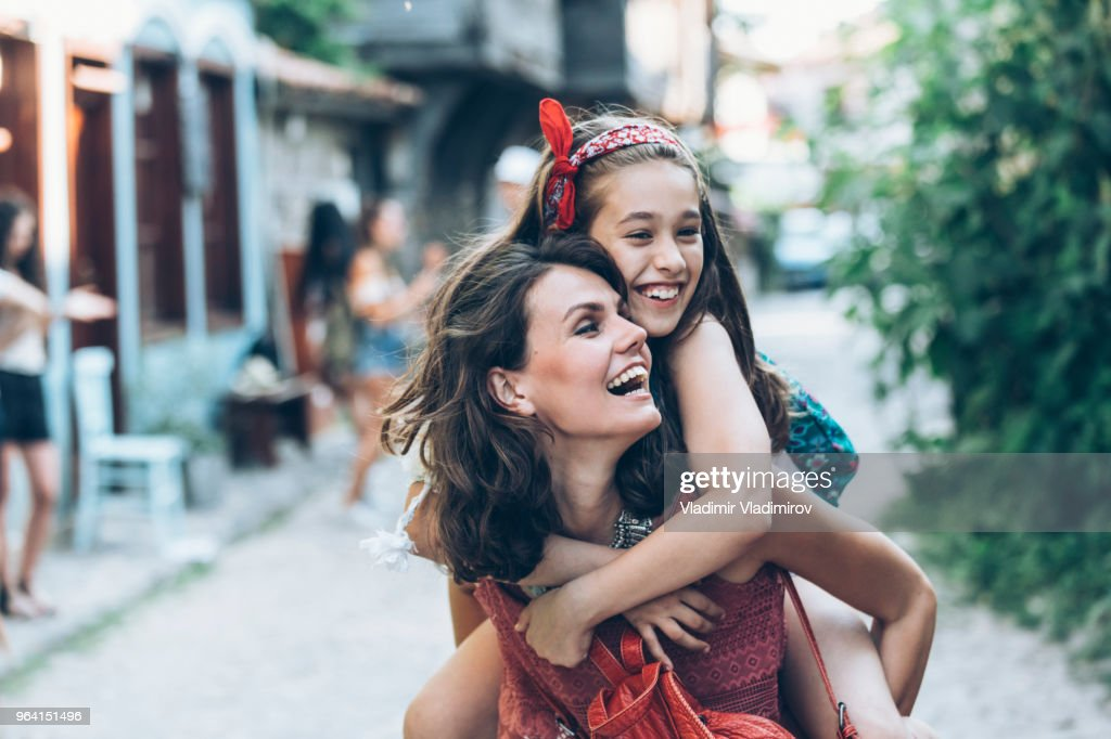 Mother and daugther having fun outdoors : Stock Photo