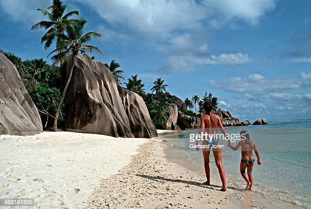 Mother and daugther on a beach on La Digue Island