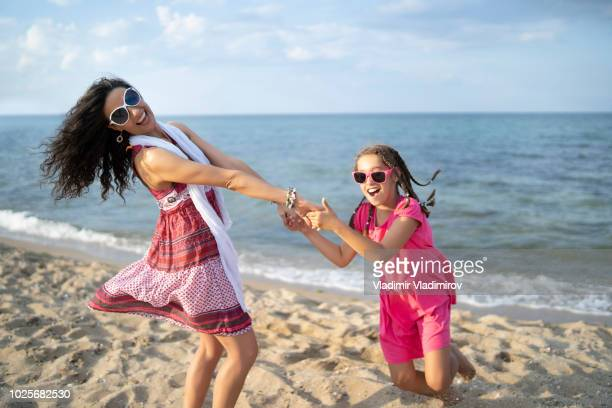 Mother and daugther playing on beach