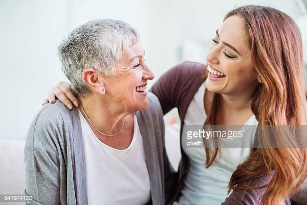 Mother and dauther laughing together
