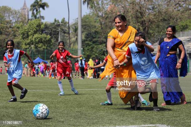 Mother and doughers take part in a soccer match during the International Women's Day in Mumbai India on March 8 2019