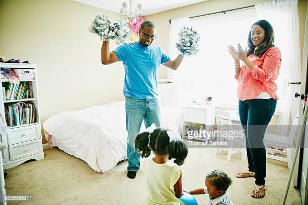 Mother and father cheering for young daughter