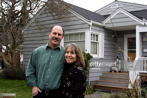 mother and father in front of home - in front of stock pictures, royalty-free photos & images