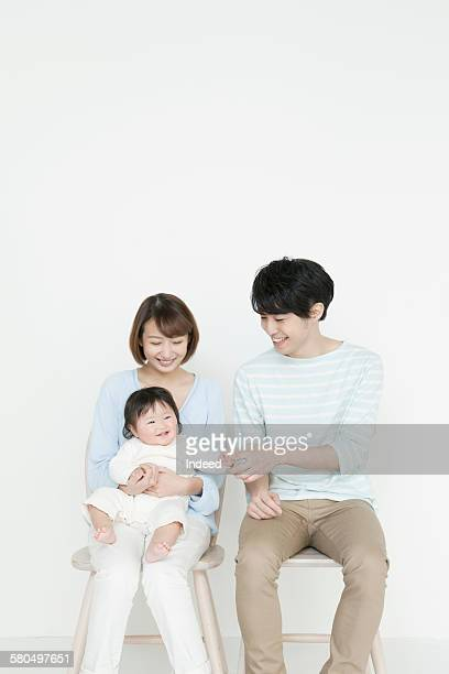 Mother and father looking at baby girl