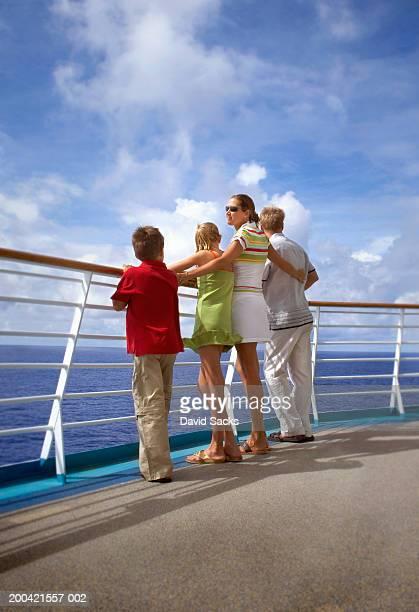 mother and father with children (10-12) near rail of cruise ship - ponte di una nave foto e immagini stock