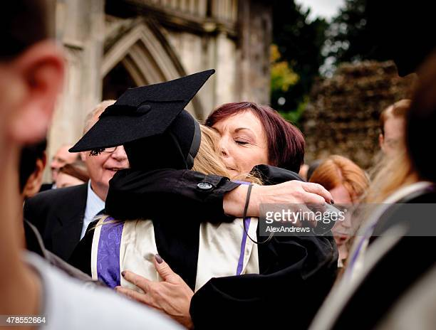 Mother and graduate daughter embrace