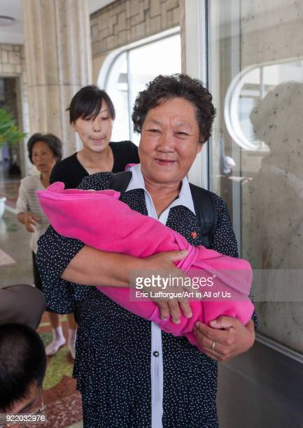 Mother and Grand mother coming out of the maternity hospital with babies Pyongan Province Pyongyang North Korea on September 8 2008 in Pyongyang...