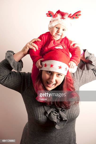 Mother and her Babby Girl in Santa`s Costume