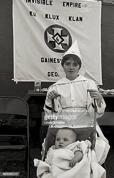 CONTENT] Mother and her baby attend a Ku Klux Klan rally in support of the Invisible Empire of Gainesville Georgia The event culminated in a cross...